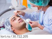 Купить «Young handsome man visiting female doctor cosmetologist», фото № 30722205, снято 16 ноября 2017 г. (c) Elnur / Фотобанк Лори