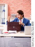 Купить «Young handsome employee working in the office», фото № 30722889, снято 12 сентября 2018 г. (c) Elnur / Фотобанк Лори