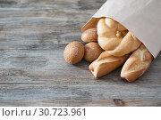 baguette on old wooden background. Стоковое фото, фотограф Майя Крученкова / Фотобанк Лори