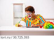 Купить «Male clown preparing for perfomance at home», фото № 30725393, снято 28 сентября 2018 г. (c) Elnur / Фотобанк Лори