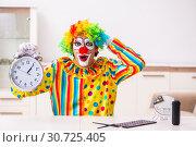Купить «Male clown preparing for perfomance at home», фото № 30725405, снято 28 сентября 2018 г. (c) Elnur / Фотобанк Лори