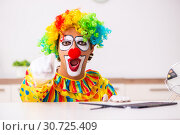 Купить «Male clown preparing for perfomance at home», фото № 30725409, снято 28 сентября 2018 г. (c) Elnur / Фотобанк Лори