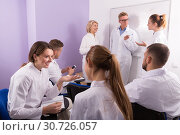 Group of smiling students medical faculty talking. Стоковое фото, фотограф Яков Филимонов / Фотобанк Лори