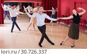 Купить «People dancing lindy hop in pairs», фото № 30726337, снято 24 мая 2017 г. (c) Яков Филимонов / Фотобанк Лори