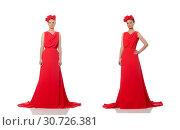 Купить «Pretty caucasian model in red long evening dress isolated on whi», фото № 30726381, снято 23 июня 2015 г. (c) Elnur / Фотобанк Лори