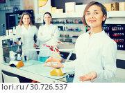 Купить «Nail technician offering color of nail polish», фото № 30726537, снято 28 апреля 2017 г. (c) Яков Филимонов / Фотобанк Лори