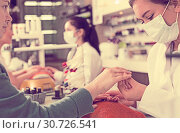 Купить «Nail masters performing manicure», фото № 30726541, снято 28 апреля 2017 г. (c) Яков Филимонов / Фотобанк Лори