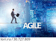 Купить «Agile transformation concept with businessman walking on tight r», фото № 30727809, снято 18 октября 2019 г. (c) Elnur / Фотобанк Лори
