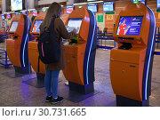 Купить «Автомат самостоятельной регистрации на авиарейс», фото № 30731665, снято 4 мая 2019 г. (c) Victoria Demidova / Фотобанк Лори