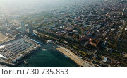 Купить «Aerial view of seaside area of Barcelona with harbor on sunny day, Catalonia, Spain», видеоролик № 30735853, снято 16 ноября 2018 г. (c) Яков Филимонов / Фотобанк Лори