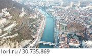 Купить «Aerial view Grenoble of city center with embankment of Isere river, France», видеоролик № 30735869, снято 5 января 2019 г. (c) Яков Филимонов / Фотобанк Лори