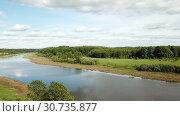 Купить «Panoramic view of gulf meadows in the floodplain of the Oka River, Russia», видеоролик № 30735877, снято 28 июня 2018 г. (c) Яков Филимонов / Фотобанк Лори