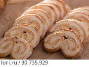 Купить «fried Palmier laid out on counter», фото № 30735929, снято 30 января 2018 г. (c) Татьяна Яцевич / Фотобанк Лори