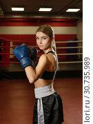 Купить «Pretty girl in boxing gloves in a gym shot», фото № 30735989, снято 11 мая 2017 г. (c) Гурьянов Андрей / Фотобанк Лори