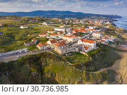 Aerial view of small town with red roofs on coastline Atlantic ocean. Top View of Azenhas Do Mar, Sintra, Portugal (2019 год). Стоковое фото, фотограф Кирилл Трифонов / Фотобанк Лори
