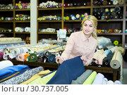 Купить «Woman looking for cloth in shop», фото № 30737005, снято 2 марта 2018 г. (c) Яков Филимонов / Фотобанк Лори
