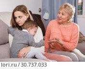 Купить «Two women are quarreling for upbringing toddler», фото № 30737033, снято 15 февраля 2018 г. (c) Яков Филимонов / Фотобанк Лори