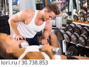 Купить «young athlete training biceps muscles», фото № 30738853, снято 4 октября 2016 г. (c) Яков Филимонов / Фотобанк Лори