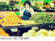 Купить «Mature woman offering fresh fruits and vegetables», фото № 30738861, снято 10 марта 2017 г. (c) Яков Филимонов / Фотобанк Лори