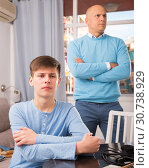 Купить «Father and teenage son after quarrel», фото № 30738929, снято 7 апреля 2019 г. (c) Яков Филимонов / Фотобанк Лори