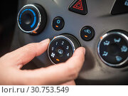 Купить «Hand opening the air conditioner in the car.», фото № 30753549, снято 10 июня 2018 г. (c) easy Fotostock / Фотобанк Лори