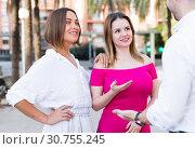 Купить «Young women are talking with stranger man who was meet», фото № 30755245, снято 18 октября 2017 г. (c) Яков Филимонов / Фотобанк Лори