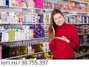Купить «Satisfied female in cosmetics store», фото № 30755397, снято 22 марта 2018 г. (c) Яков Филимонов / Фотобанк Лори