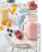 Купить «Berry smoothies on the wooden board», фото № 30759897, снято 17 июня 2018 г. (c) easy Fotostock / Фотобанк Лори