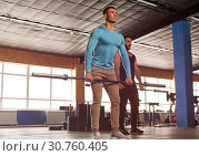 Купить «Group of Sporty Athletic Men Training With Barbells.», фото № 30760405, снято 3 февраля 2019 г. (c) Pavel Biryukov / Фотобанк Лори