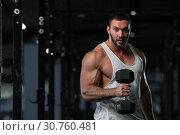 Купить «Handsome Athletic Young Man With Dumbbells», фото № 30760481, снято 3 февраля 2019 г. (c) Pavel Biryukov / Фотобанк Лори
