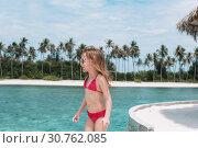 Купить «Adorable little girl at beach during summer vacation», фото № 30762085, снято 28 марта 2015 г. (c) Дмитрий Травников / Фотобанк Лори