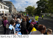 Купить «UK SCOTLAND Edinburgh -- 16 Sep 2010 -- Crowds wave papal flags and those of St Andrew during Pope Benedict XVI's visit to Edinburgh, Scotland. The pope...», фото № 30765613, снято 16 сентября 2010 г. (c) age Fotostock / Фотобанк Лори