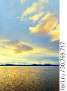 Купить «Sea sunset landscape. Sea water surface lit by soft sunset light. Summer sunny water scene in picturesque tones», фото № 30769717, снято 26 августа 2013 г. (c) Зезелина Марина / Фотобанк Лори