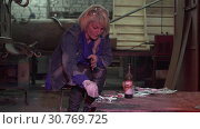Купить «Young Female Paints An Iron Surface», видеоролик № 30769725, снято 16 июля 2020 г. (c) Pavel Biryukov / Фотобанк Лори
