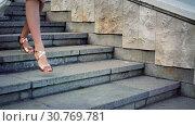Купить «Girl runs on steps high heels stiletto street city outdoor», видеоролик № 30769781, снято 10 мая 2019 г. (c) Gennadiy Poznyakov / Фотобанк Лори