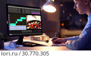 Купить «editor working on video file on computer at night», видеоролик № 30770305, снято 24 января 2020 г. (c) Syda Productions / Фотобанк Лори