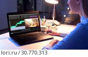 Купить «editor working on video file on laptop at night», видеоролик № 30770313, снято 24 января 2020 г. (c) Syda Productions / Фотобанк Лори
