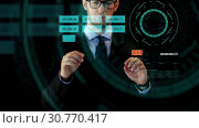 Купить «businessman working with data on virtual screen», видеоролик № 30770417, снято 26 января 2020 г. (c) Syda Productions / Фотобанк Лори