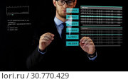Купить «businessman working with data on virtual screen», видеоролик № 30770429, снято 16 мая 2019 г. (c) Syda Productions / Фотобанк Лори