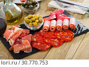 Купить «Spanish sausage sliced - chorizo, fuet, jamon, salami, bacon», фото № 30770753, снято 18 июля 2019 г. (c) Яков Филимонов / Фотобанк Лори