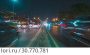 Купить «Hyperlapse of night city traffic on street intersection. Timelapse of cars and motorbikes movement.», видеоролик № 30770781, снято 1 декабря 2018 г. (c) Александр Маркин / Фотобанк Лори