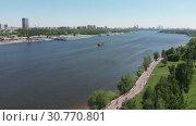 Купить «Traffic along North River Port on Moscow Canal in Moscow, Russia.», видеоролик № 30770801, снято 18 ноября 2019 г. (c) Володина Ольга / Фотобанк Лори