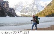 Купить «Young woman hiking on a lago di braies coast», видеоролик № 30771281, снято 19 мая 2019 г. (c) Константин Шишкин / Фотобанк Лори