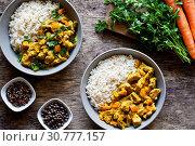 Купить «Bowls of homemade curry dish with fresh vegetables and rice», фото № 30777157, снято 17 сентября 2018 г. (c) easy Fotostock / Фотобанк Лори