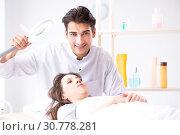 Купить «Young woman visiting male doctor cosmetologist», фото № 30778281, снято 16 ноября 2017 г. (c) Elnur / Фотобанк Лори