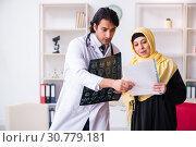 Купить «Female arab patient visiting male doctor», фото № 30779181, снято 1 февраля 2019 г. (c) Elnur / Фотобанк Лори