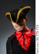 Купить «Man pirate against dark background», фото № 30779713, снято 11 марта 2015 г. (c) Elnur / Фотобанк Лори