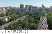 Купить «Top view of the district Severnoye Tushino in Moscow, Russia.», видеоролик № 30780401, снято 23 мая 2019 г. (c) Володина Ольга / Фотобанк Лори