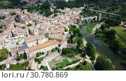Купить «Aerial view of historic centre of Besalu with Romanesque bridge over Fluvia river, Catalonia, Spain», видеоролик № 30780869, снято 23 июня 2018 г. (c) Яков Филимонов / Фотобанк Лори