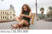 Купить «Young sexy girl tourist in dress playfully posing port of Barcelona, Spain», видеоролик № 30781009, снято 27 октября 2018 г. (c) Яков Филимонов / Фотобанк Лори